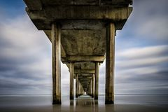 Long exposure of Scripps pier in La Jolla, California during the early morning Royalty Free Stock Photography