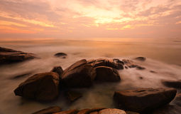 Long exposure of sea and rock in evening. Stock Photography