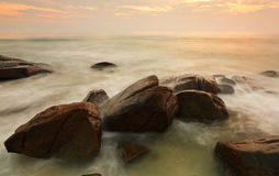 Long exposure of sea and rock in evening. Royalty Free Stock Photos