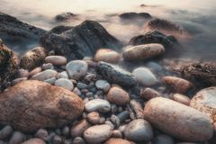 Long exposure of sea and rocks stock image