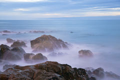 Long exposure of sea with rocks Stock Image