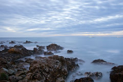 Long exposure of sea with rocks Stock Photo