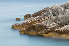 Long exposure of sea and rocks on the island Kefalonia, Greece. Royalty Free Stock Photos