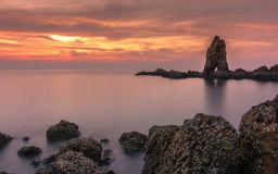 Long exposure of sea and rocks at sunset Royalty Free Stock Image