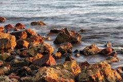 Long exposure of sea and rocks, sunset over the sea , long expos Stock Image