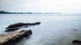 Long Exposure of Sea with Smooth Wave and Rock landscape. Nature of Seascape vacation holiday season time for relax travel