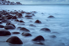 Long exposure of sea and stones, Lofoten, Norway Stock Image
