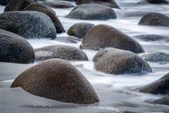 Long exposure of sea and stones on the Utakleiv beach, Lofoten i Royalty Free Stock Photo