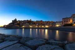 Long exposure in the sea village at night with color houses/ Genoa/Italy/reflexes/lights/ night royalty free stock photography