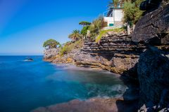 Long exposure seascape in a beautiful sunny day in summertime in ligurian coast of Genoa province, Italy royalty free stock photo