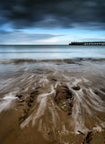 Long exposure seascape landscape during dramatic evening in Wint Stock Image