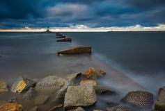 Long exposure seascape with stone breakwater Stock Photos