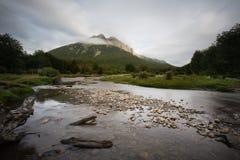 Long exposure of shallow lake before mountain range. Ushuaia, Patagonia, Argentina Royalty Free Stock Images