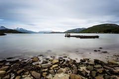 Long exposure of shallow lake before mountain range. Ushuaia, Patagonia, Argentina Stock Photos