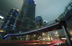 Long exposure shooting night busy street Stock Photo