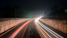 Long exposure shot of a busy freeway at night stock photos