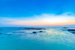 Long exposure shot of calmness sea and the rock in sunset Royalty Free Stock Images