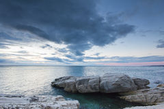 Long exposure shot of clouds passing by on the rocks Royalty Free Stock Photography