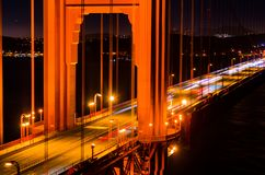 Golden Gate Bridge at night with car trails. stock images