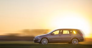 Long exposure shot of gray silver car moving fast in countryside royalty free stock image