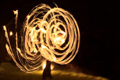 Long exposure shot of moving burning torches and fire Stock Photos