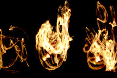 Long exposure shot of moving burning torches and fire Stock Photo