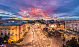 Long exposure shot of the Revolution Square near Victoria Avenue in Bucharest, Romania. Traffic and historical buildings.Bucuresti royalty free stock images