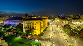 Long exposure shot of the Revolution Square near Victoria Avenue in Bucharest, Romania. Traffic and historical buildings.Bucuresti royalty free stock photography