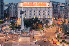 Long exposure shot of the Revolution Square,Victoria Avenue in Bucharest, Romania. Traffic and historical buildings(Close-up royalty free stock photo