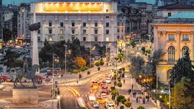Long exposure shot of the Revolution Square, Victoria Avenue in Bucharest, Romania. Traffic and historical buildings. Panorama stock photo