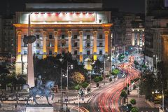 Long exposure shot of the Revolution Square, Victoria Avenue in Bucharest, Romania. Traffic and historical buildings. Panorama stock photography