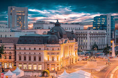 Long exposure shot of the Revolution Square, Victoria Avenue in Bucharest, Romania. Traffic and historical buildings (Panorama royalty free stock image