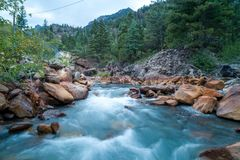 Silky River Flow. Long exposure shot of a river running through rocks Stock Images