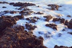 Long exposure shot, rocks in the water. Black Sea. Royalty Free Stock Photos