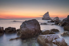Long exposure shot of stones on the sea Royalty Free Stock Photography
