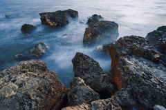 Long exposure shot, stones in the water. Black Sea. Royalty Free Stock Images