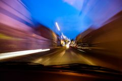 Long exposure shot of a street inside a car royalty free stock images