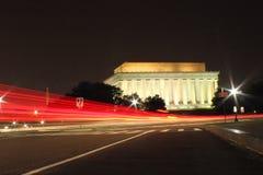 Long exposure shot of Washington DC landmark. Lincoln momerial with Washington monument at night. The car tails are amazingly beautiful Stock Photography