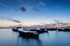 Long exposure silhouette long tail boats with sunrise sky in Koh Lipe Island Stock Images