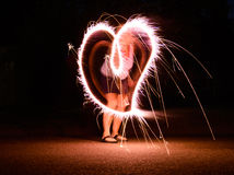 Long exposure of sparkler making a heart shape Stock Photo