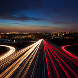 Long Exposure Speed Traffic at night  in the city. Speed Traffic at night  in the city - light trails on motorway highway at dusk,  long exposure, urban Stock Photos