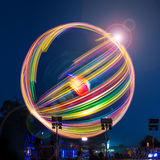 Long exposure of a spinning fairground ride. A long exposure photograph of a spinning fairground ride Stock Photo