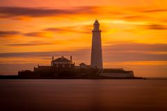 St Mary`s Lighthouse at sunrise stock photography
