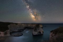 Milky Way Galaxy over Shark Fin Cove. Long exposure of the stars and milky way galaxy over Shark Fin Cove in California stock photos
