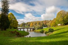 Stourhead Gardens. Long exposure of Stourhead Gardens of the National trust on an Autumn afternoon with the colours turning stock photos