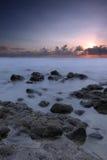 Long exposure at sunrise. A beautiful long exposure sunrise at Black Stone Beach, Kuantan, Pahang, Malaysia Stock Images