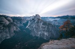 Long exposure of sunrise clouds climbing over Half Dome royalty free stock photos