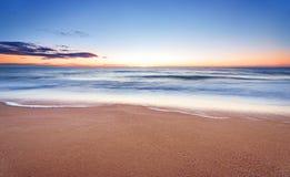 Long exposure sunrise. Long exposure seascape sunset. Blue sky Stock Image