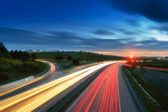 Long-exposure sunset over a highway. With light trails stock photography