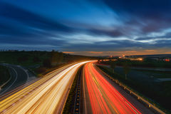 Long-exposure sunset over a highway Royalty Free Stock Photography